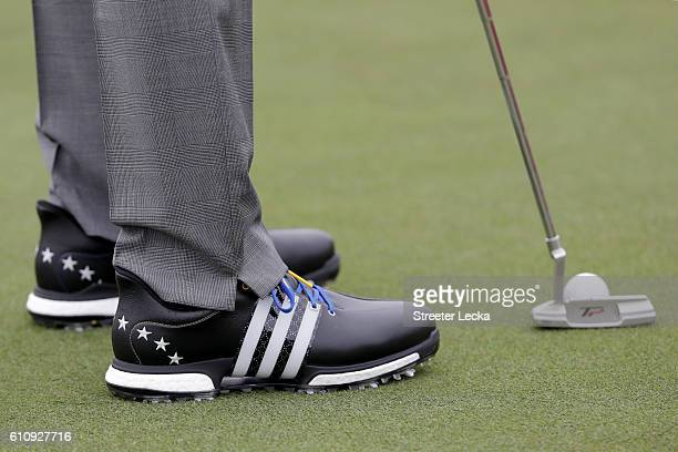 A detail view of Sergio Garcia of Europe's Adidas shoes as he putts prior to the 2016 Ryder Cup at Hazeltine National Golf Club on September 28 2016...