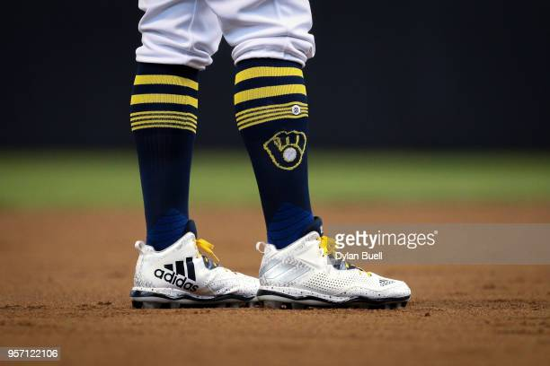 A detail view of the Adidas cleats worn by Travis Shaw of the Milwaukee Brewers during the game against the Cleveland Indians at the Miller Park on...