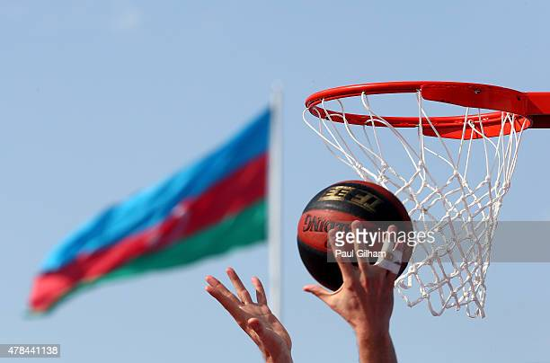 A detail view of the ball and basket with the flag of Azerbaijan during the Men's 3x3 Basketball round of 16 knockout stage during day thirteen of...