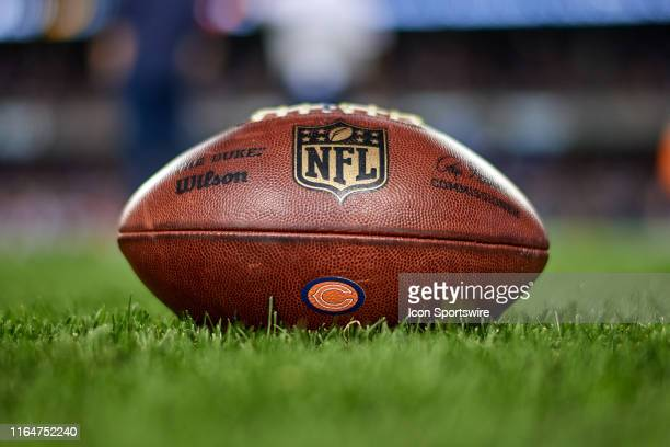 A detail view of the Chicago Bears logo and NFL crest logo is seen on a NFL football prior to game action during a preseason NFL game between the...