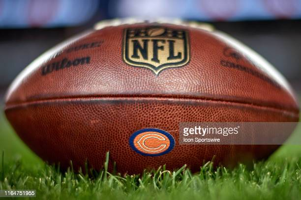 A detail view of the Chicago Bears logo is seen on a NFL football prior to game action during a preseason NFL game between the Chicago Bears and the...