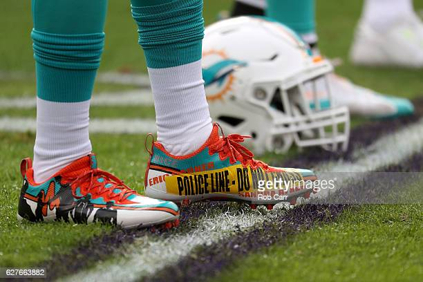 A detail view of the cleats of free safety Michael Thomas of the Miami Dolphins prior to a game against the Baltimore Ravens at MT Bank Stadium on...