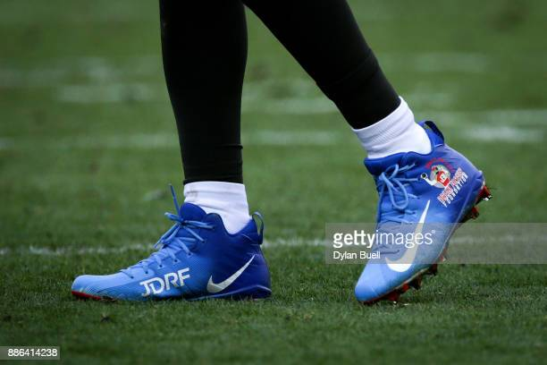 A detail view of the custom cleats worn by Jameis Winston of the Tampa Bay Buccaneers in the third quarter against the Green Bay Packers at Lambeau...
