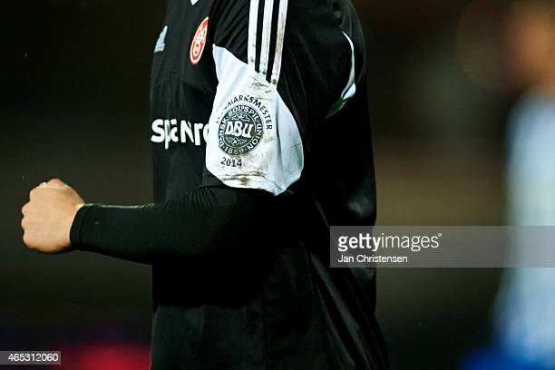 Detail view of the DBU logo during the Danish DBU Pokalen Cup match between Esbjerg FB and AaB Aalborg at Blue Water Arena on March 5 2015 in Esbjerg...