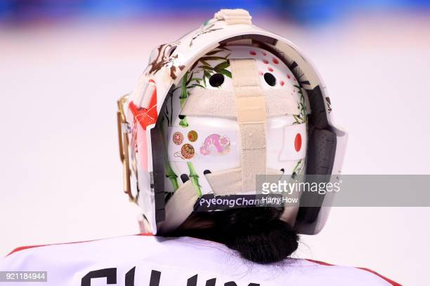 A detail view of the goalie helmet worn by Nana Fujimoto of Japan as she looks on in the third period against Switzerland during the Women's Ice...