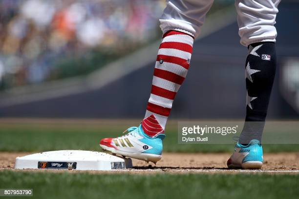 A detail view of the Independence Day themed socks and Adidas cleats worn by Keon Broxton of the Milwaukee Brewers in the first inning against the...