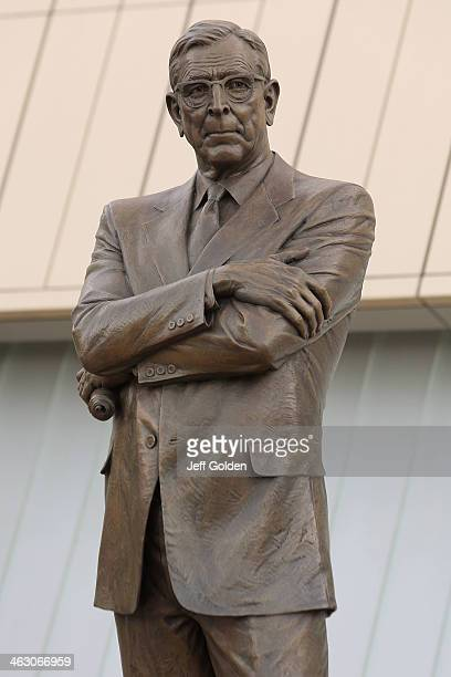 Detail view of the John R Wooden bronze statue outside the service entrance of the arena before the game between the USC Trojans and the UCLA Bruins...