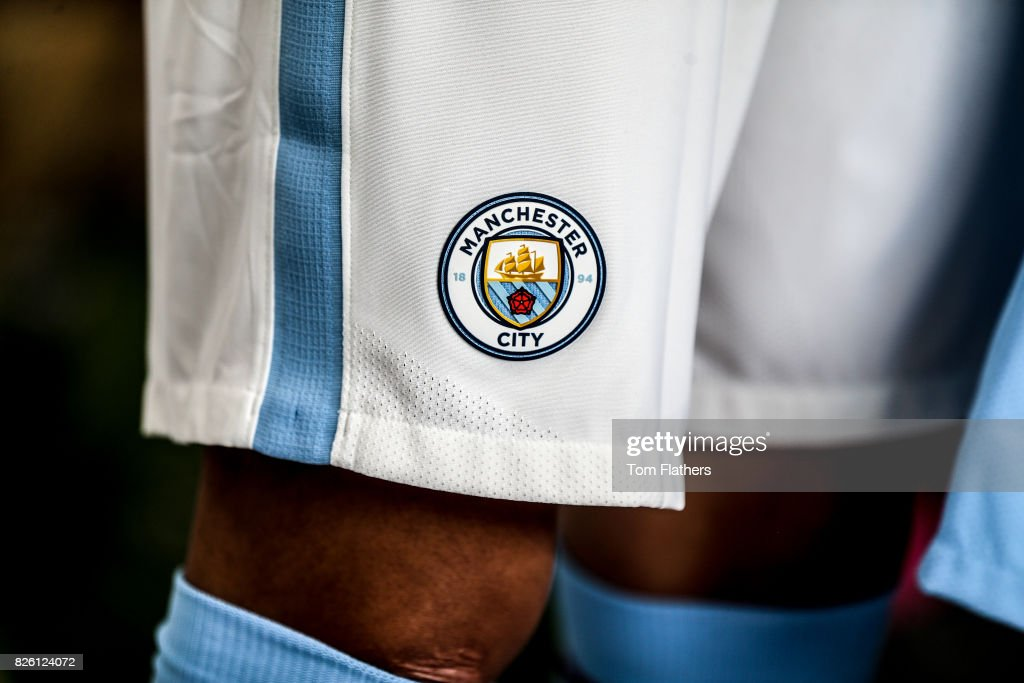 A detail view of the Manchester City badge on the shorts of the new kit.