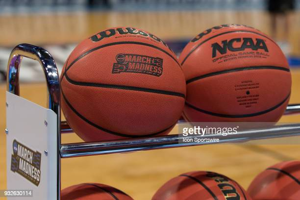 A detail view of the March Madness logo that is embossed into the official tournament basketballs is seen during an open public practice during the...