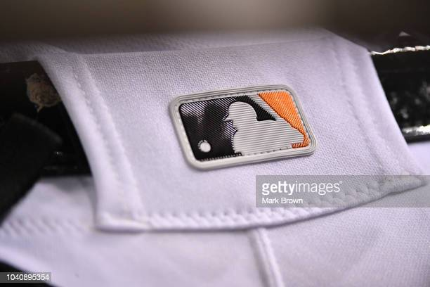 A detail view of the MLB logo on the baseball pants of Starlin Castro of the Miami Marlins during the game against the Washington Nationals at...