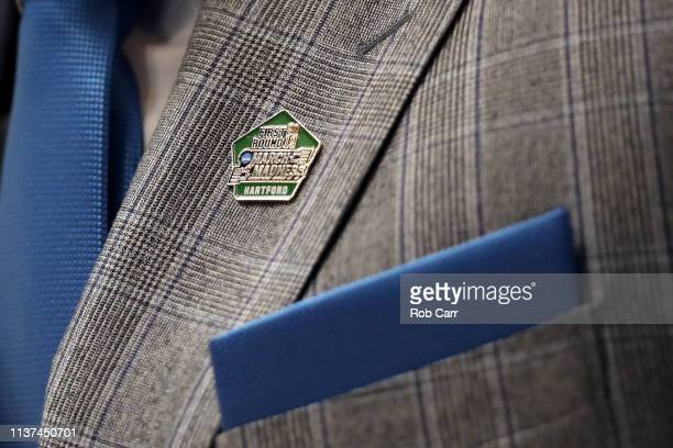 Detail view of the NCAA Tournament pin worn by head coach Jay Wright of the Villanova Wildcats on his jacket during the 2019 NCAA Men's Basketball...