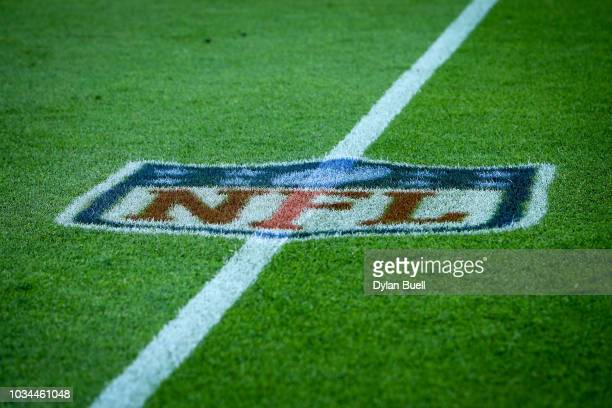 A detail view of the NFL logo on the field before the game between the Green Bay Packers and Chicago Bears at Lambeau Field on September 9 2018 in...
