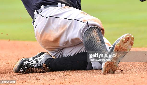 A detail view of the Under Armour baseball shoes worn by Nick Castellanos of the Detroit Tigers as he slides into third base during the Spring...
