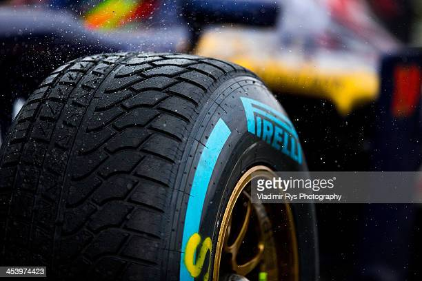A detail view of the wet Pirelli tyre is pictured on the STR8 of Daniel Ricciardo of Australia and Scuderia Toro Rosso during practice prior...
