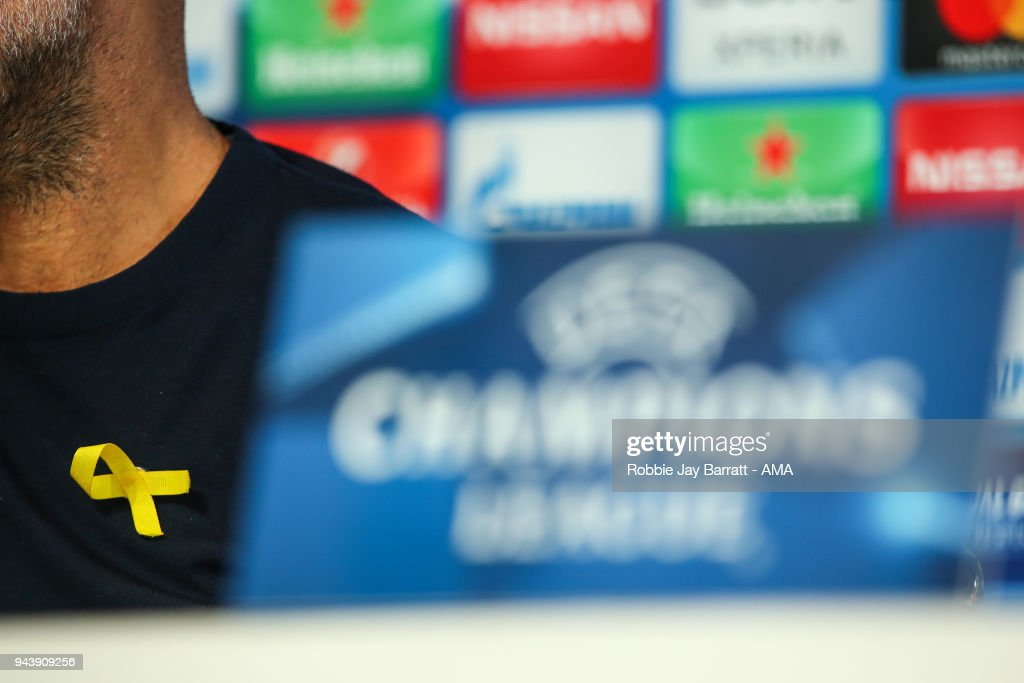 A detail view of the yellow ribbon on Pep Guardiola the head coach / manager of Manchester City chest in support of Catalan independence during a Press Conference and Training Session at Manchester City Football Academy on April 9, 2018 in Manchester, England.