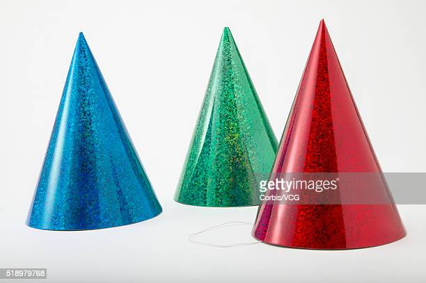 detail view of three party hats - cone shape stock photos and pictures