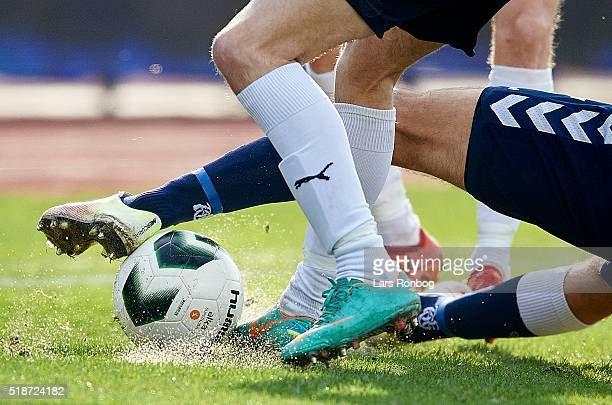 Detail view of two players tackle the ball during the Danish Alka Superliga match between AGF Aarhus and Hobro IK at Ceres Park on April 2, 2016 in...