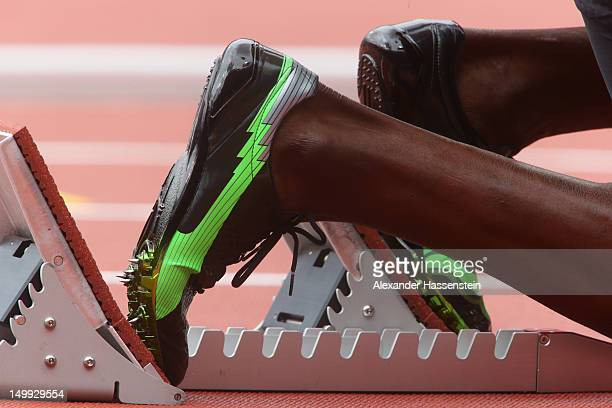 A detail view of Usain Bolt of Jamaica sneakers on the starters block prior to the Men's 200m Round 1 Heats on Day 11 of the London 2012 Olympic...