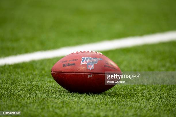 Detail view of Wilson NFL football with the NFL 100 logo on the field before the game between the Buffalo Bills and the Washington Redskins at New...