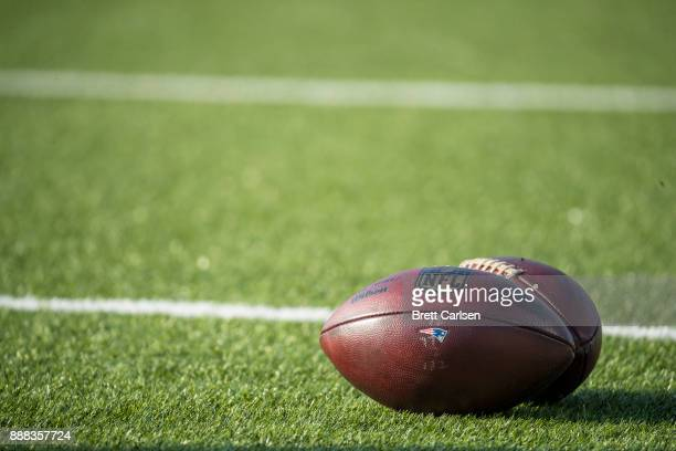 Detail view of Wilson NFL footballs bearing the New England Patriots logo set on the field before the game against the Buffalo Bills at New Era Field...