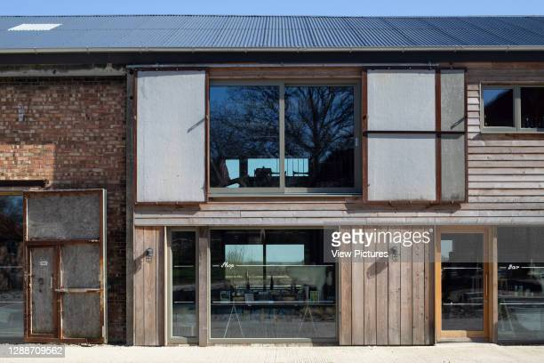 Detail view of windows and old window shutters. Tillingham Winery, Tillingham, United Kingdom. Architect: RX Architects, 2020.