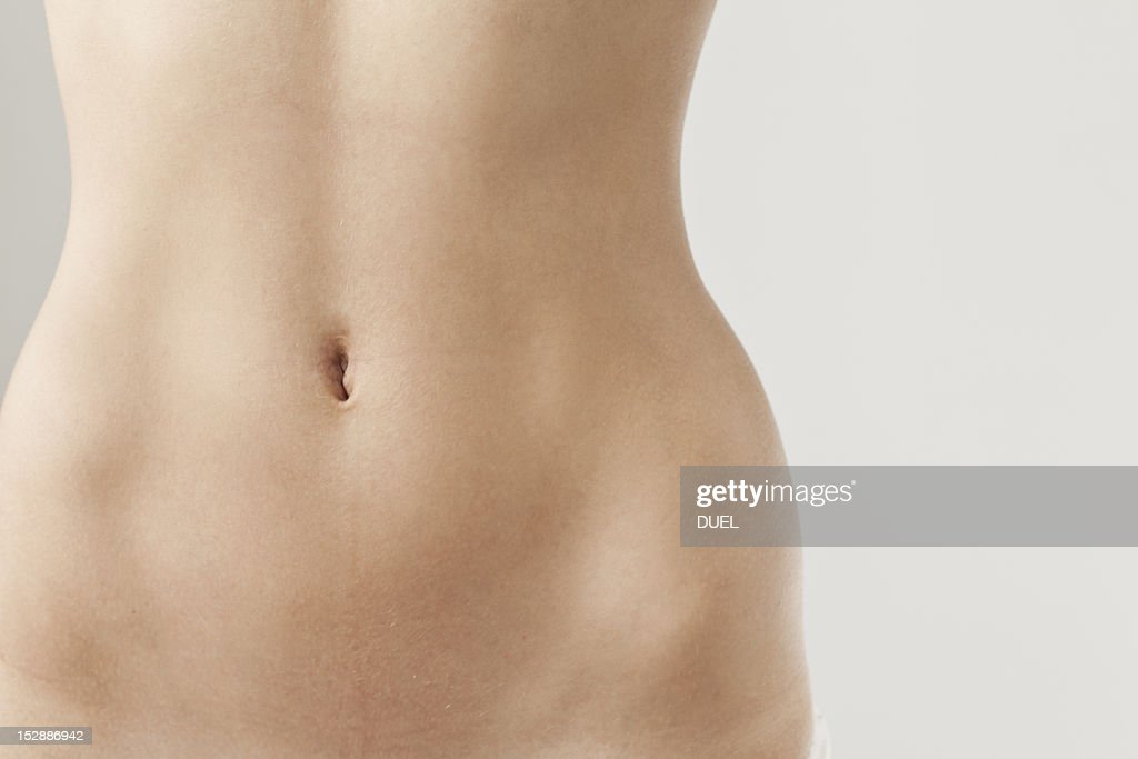 Detail view of womans naked belly : Stock Photo