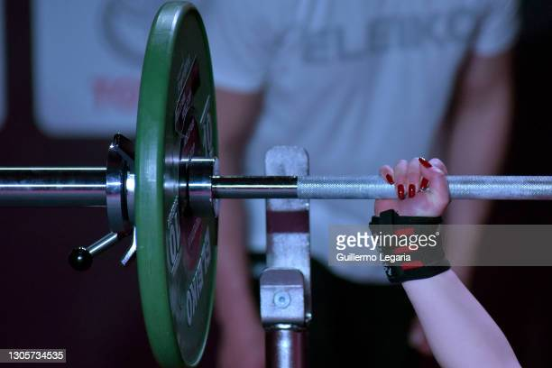 Detail whilw Nino Sabashvili of Georgia competes in the women's up to 73 kg category at the Para Powerlifting World Cup on March 06, 2021 in Bogota,...