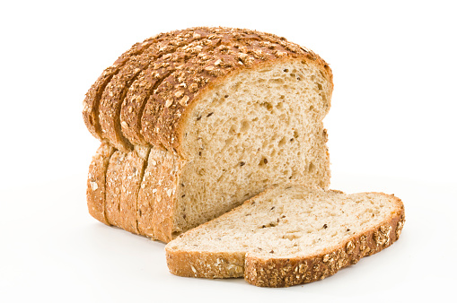 Detailed close-up of sliced grain bread on white background 157587362