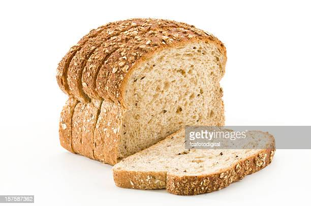 Detailed close-up of sliced grain bread on white background