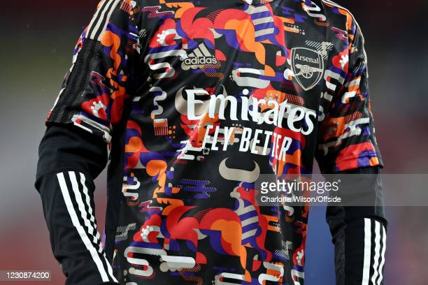 Detailed close-up view of Arsenal's training top inspired by the Chinese new year of the Ox before the Premier League match between Arsenal and...