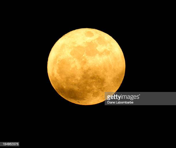 detailed image of yellow moon on a black background