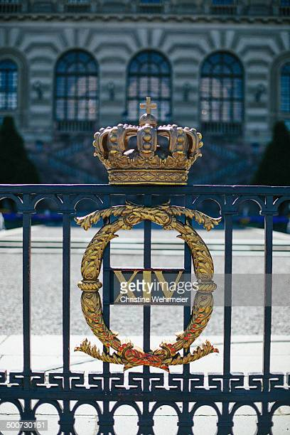 CONTENT] Detailed photo of a guilded crown on the fence of the courtyard of the Royal Palace of Stockholm