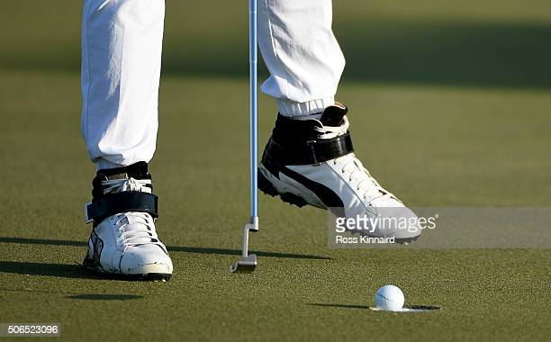 A detailed picture showing the shoes of Rickie Fowler of the United States during the continuation of the third round of the Abu Dhabi HSBC Golf...