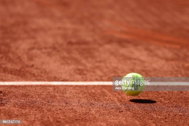 A detailed shot as the match ball bounces during the mens singles second round match between John Isner of The United States and Paolo Lorenzi of...