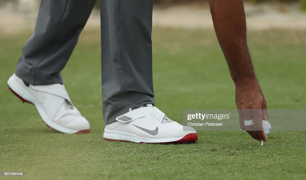 A detailed shot is seen as Tiger Woods tees up his ball during round three of the Hero World Challenge at Albany, The Bahamas on December 3, 2016 in Nassau, Bahamas.