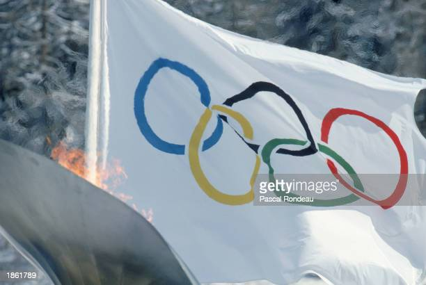 Detailed shot of Olympic flame and flag during the 1992 Winter Olympics Day 3 in Albertville France