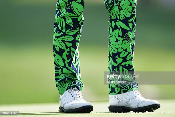 A detailed shot of pants and shoes worn by Justin Thomas of the United States are seen as he plays the 15th green during the first round of the 2016...