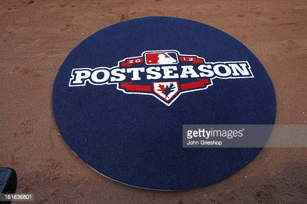 A detailed shot of the Major League Baseball postseason logo on the on deck circle before Game 3 of the National League Division Series between the...