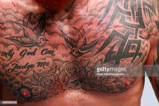 A detailed veiw of the chest and tattoos on Jim Wallhead of England after his fight against Jessin Ayari of Germany compete in their Welterweight...