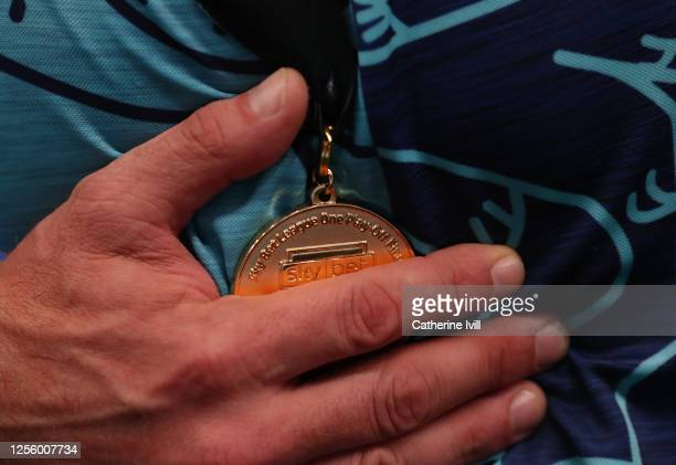 Detailed view as a player holds the winners medal after the Sky Bet League One Play Off Final between Oxford United and Wycombe Wanderers at Wembley...