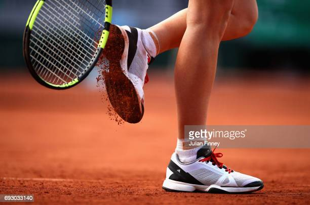 A detailed view as Caroline Wozniacki of Denmark clears the clay from her trainer during the ladies singles Quarter Finals match against Jelena...