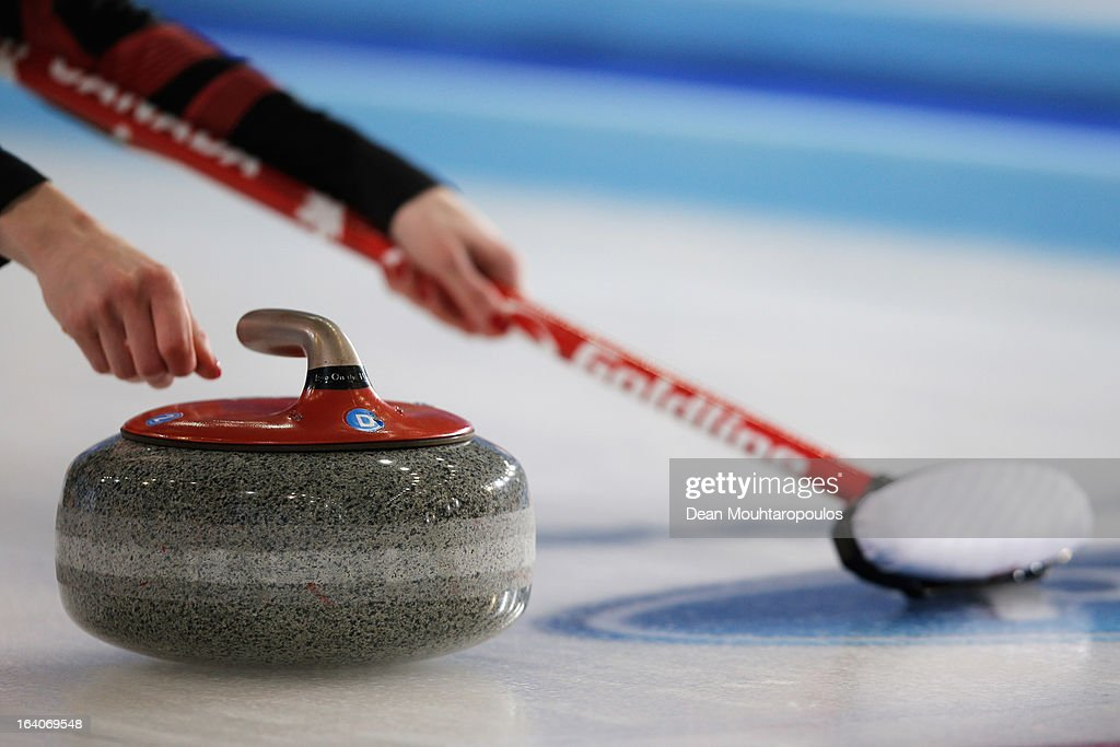 A detailed view as Lisa Weagle of Canada throws the stone and holds her broom in the match between Canada and Sweden on Day 4 of the Titlis Glacier Mountain World Women's Curling Championship at the Volvo Sports Centre on March 19, 2013 in Riga, Latvia.