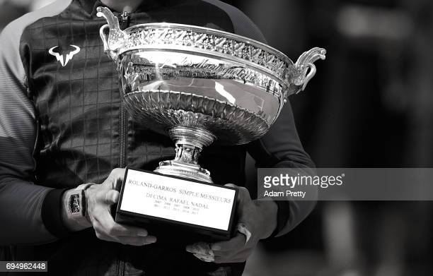A detailed view as Rafael Nadal of Spain holds the Decima trophy following his victory in the mens singles final against Stan Wawrinks of Switzerland...