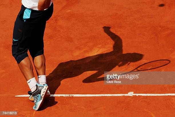 A detailed view as Rafael Nadal of Spain serves to Carlos Moya of Spain during the Men's Singles Quarter Final match on day eleven of the French Open...