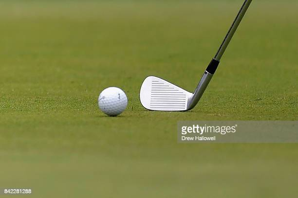 Detailed view as Sergio Garcia of Spain putts with an iron on the 18th green during round three of the Dell Technologies Championship at TPC Boston...