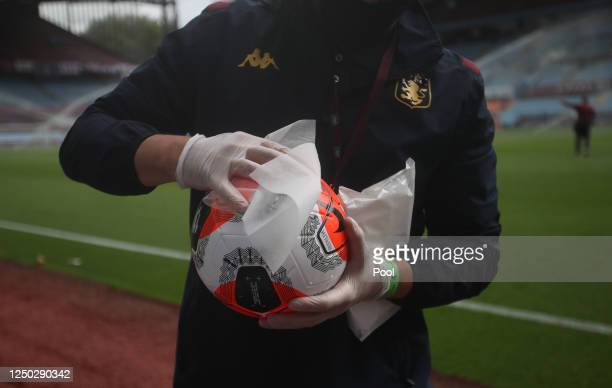 Detailed view as the match ball is disinfected after the players warm up prior to the Premier League match between Aston Villa and Sheffield United...