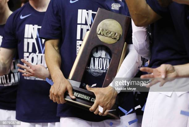 A detailed view as the Villanova Wildcats celebrate with the East Regional Champion trophy after defeating the Texas Tech Red Raiders 7159 in the...