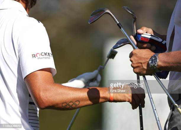 A detailed view is seen as Rickie Fowler of the United States exchanges clubs during a practice round prior to the 2019 US Open at Pebble Beach Golf...