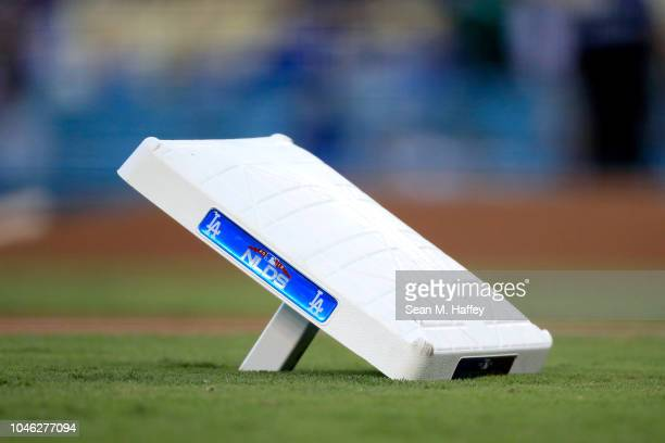 A detailed view of a base during batting practice prior to Game Two of the National League Division Series between the Los Angeles Dodgers and the...