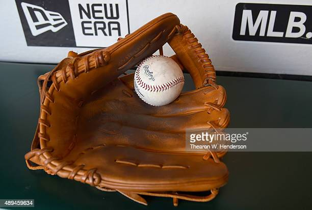 A detailed view of a baseball and baseball glove belonging to Brandon Drury of the Arizona Diamondbacks sitting in the dugout prior to the game...